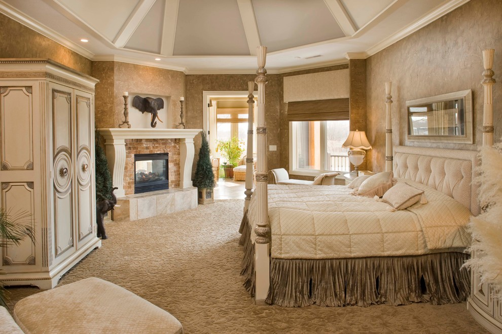 Bedroom - large mediterranean master carpeted bedroom idea in Indianapolis with multicolored walls, a two-sided fireplace and a stone fireplace