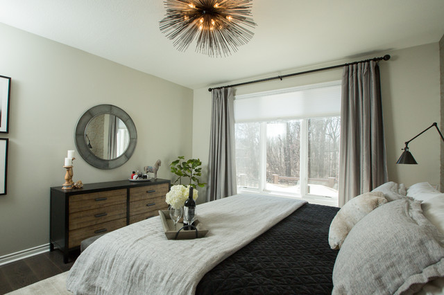 Example of a mid-sized eclectic master dark wood floor and brown floor bedroom design in Other with gray walls