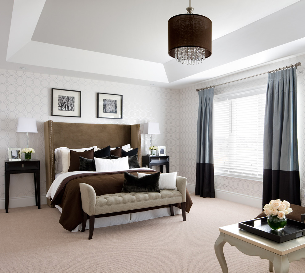 Example of a transitional carpeted and beige floor bedroom design in Toronto with gray walls
