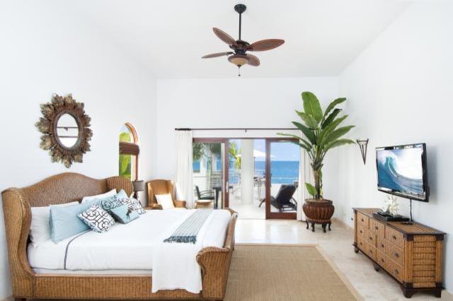 Judi Randall, Classic Home Interiors tropical-bedroom