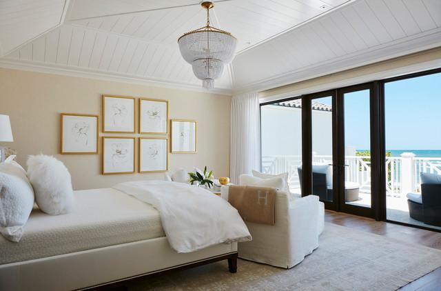 Coastal master bedroom photo in Miami with beige walls