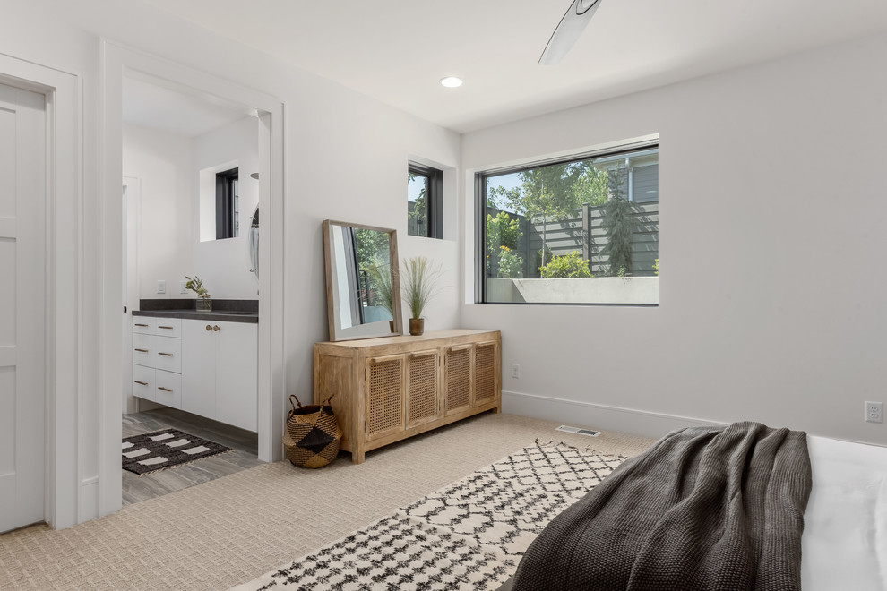 Large trendy guest porcelain tile and gray floor bedroom photo in Salt Lake City with white walls and no fireplace