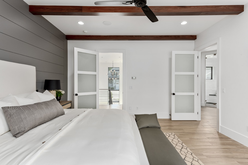 Example of a large trendy master porcelain tile and beige floor bedroom design in Salt Lake City with gray walls and no fireplace