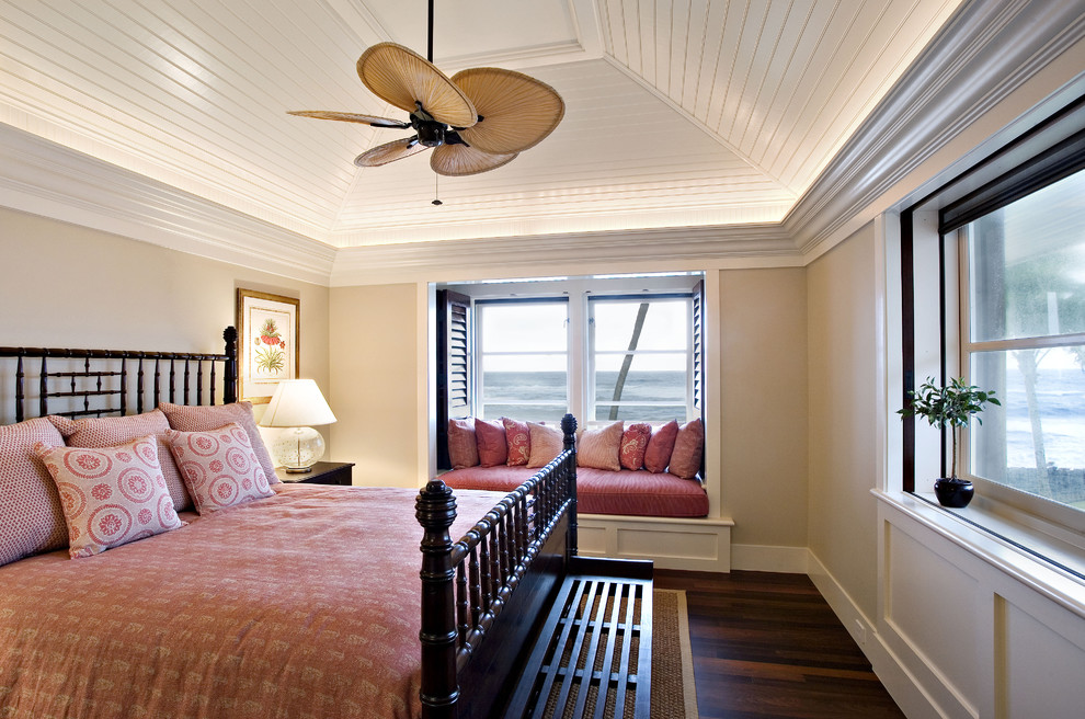Inspiration for a tropical dark wood floor bedroom remodel in San Francisco with beige walls