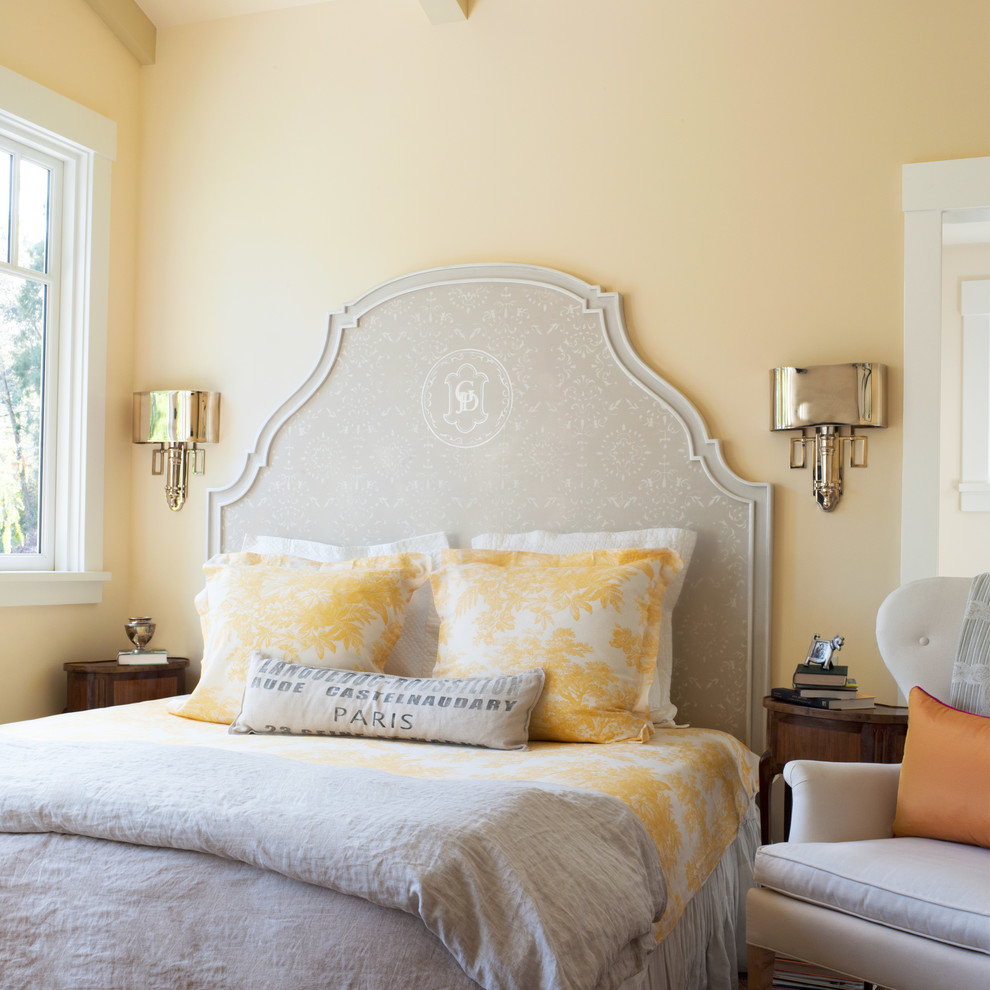 Large elegant guest bedroom photo in San Francisco with yellow walls