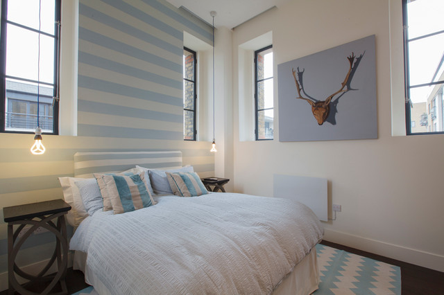 Bedroom - contemporary bedroom idea in London with white walls