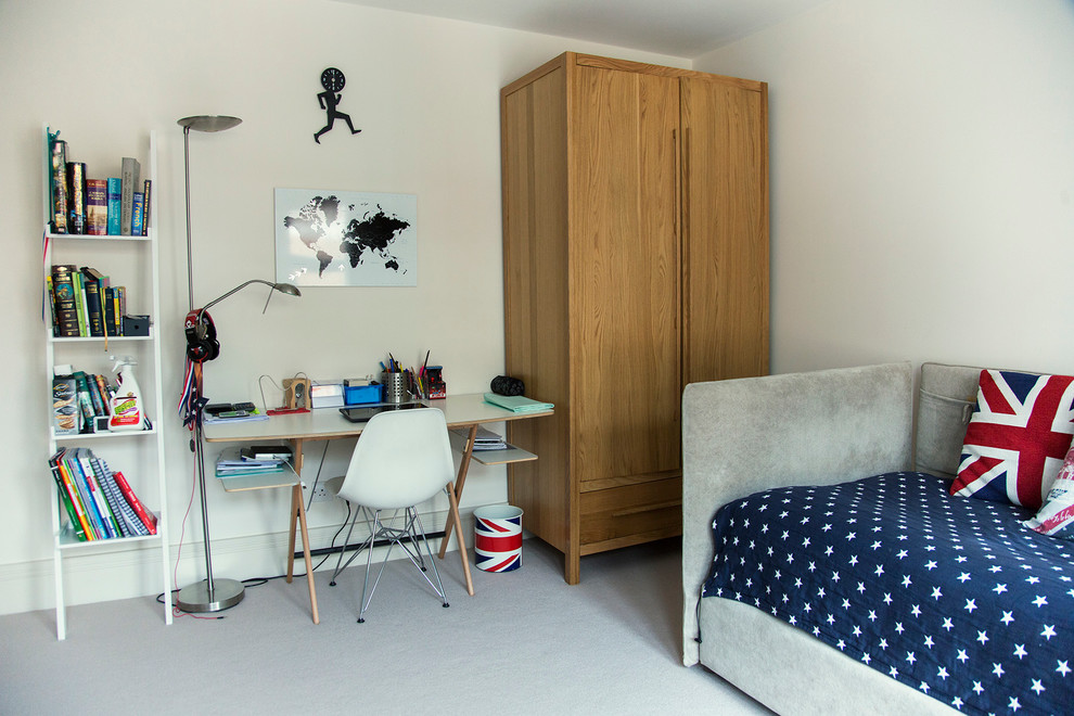 Mid-sized elegant carpeted bedroom photo in London with white walls
