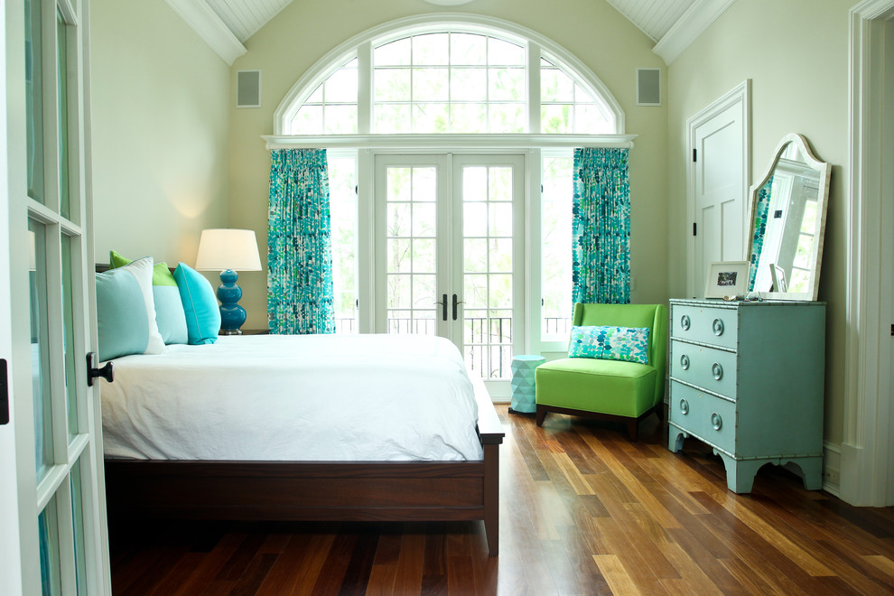 Beach style medium tone wood floor bedroom photo in Charleston with beige walls