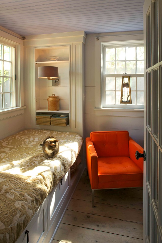 Inspiration for a farmhouse light wood floor bedroom remodel in New York with beige walls