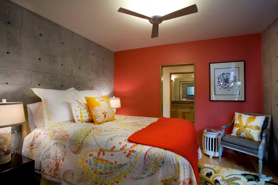 Mid-sized urban guest brown floor and medium tone wood floor bedroom photo in Salt Lake City with red walls and no fireplace