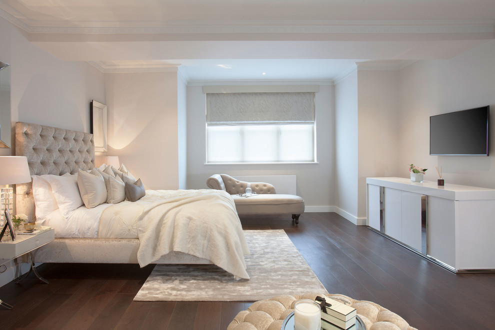 Transitional master dark wood floor bedroom photo in London with white walls