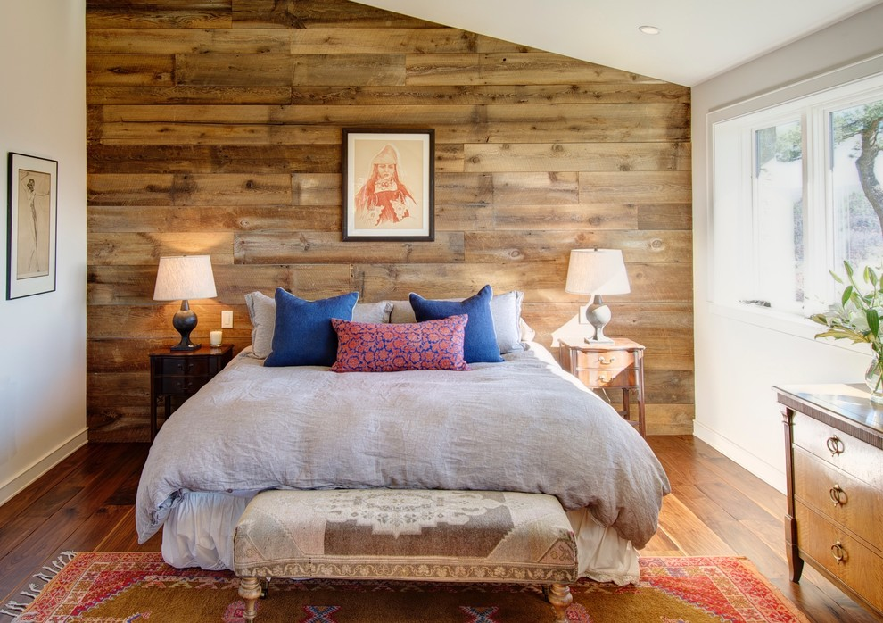 Bedroom - southwestern master medium tone wood floor bedroom idea in Boston with white walls and no fireplace
