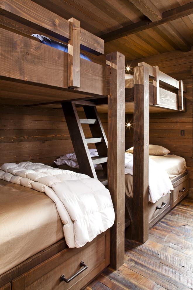 Inspiration for a rustic guest medium tone wood floor bedroom remodel in Albuquerque