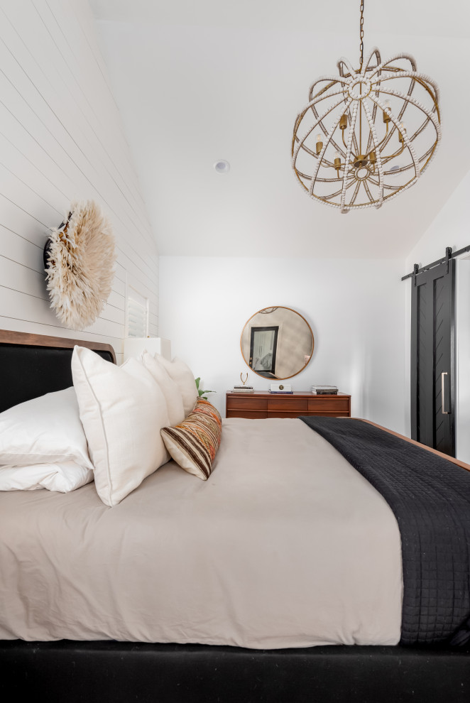 Example of a mid-sized transitional master bedroom design in Charleston with white walls