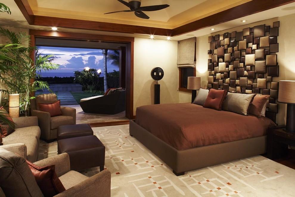 Bedroom - tropical master bedroom idea in Hawaii with beige walls