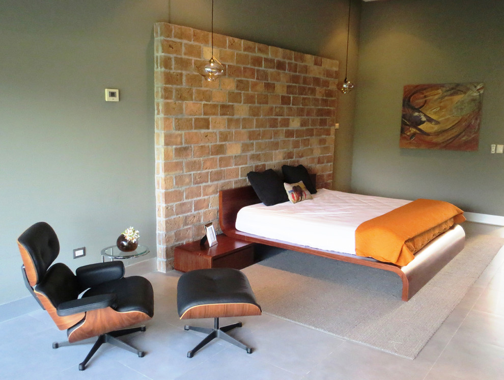 Example of a large minimalist master ceramic tile bedroom design in Los Angeles