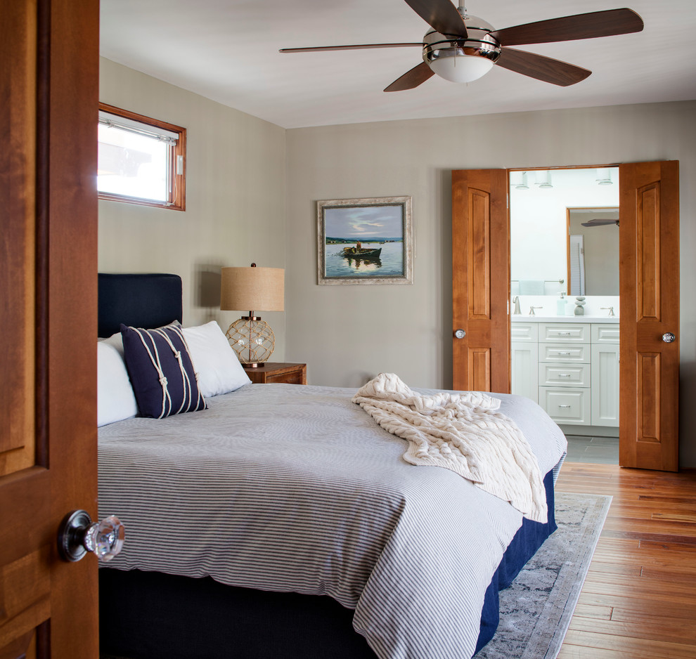 Large beach style master bamboo floor bedroom photo in San Francisco with beige walls and no fireplace