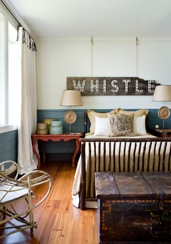 Inspiration for a rustic master medium tone wood floor and brown floor bedroom remodel in Atlanta with white walls