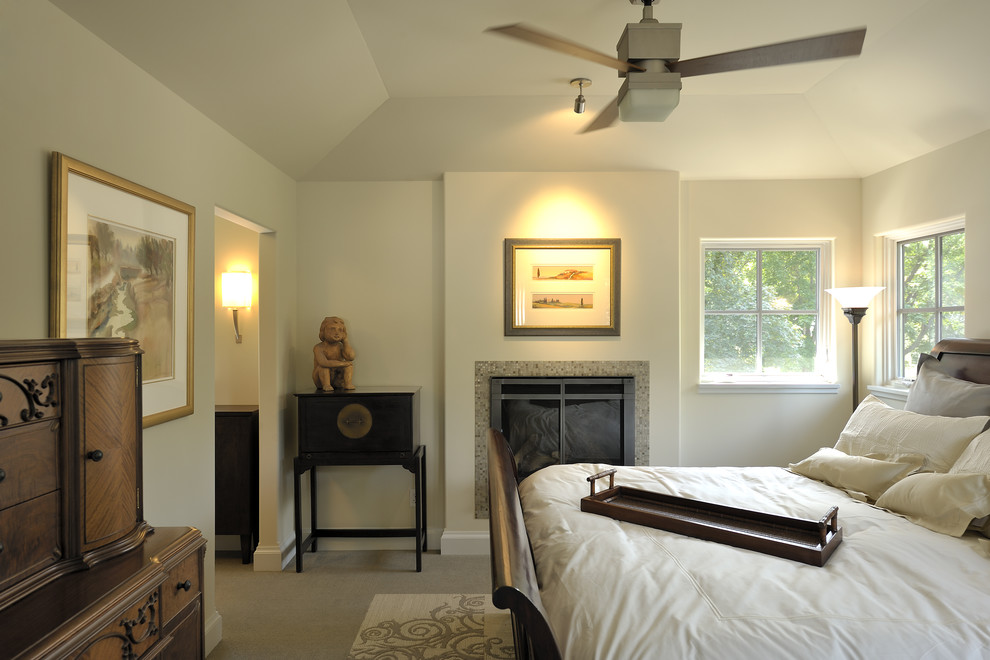 Bedroom - contemporary carpeted bedroom idea in Minneapolis with beige walls and a standard fireplace