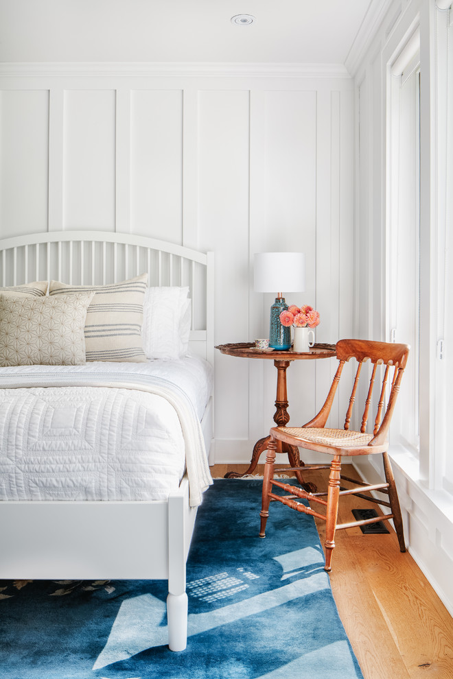 Example of a mid-sized beach style master medium tone wood floor and brown floor bedroom design in Toronto with white walls