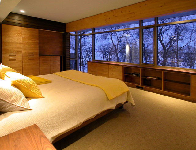 Example of a minimalist bedroom design in Other