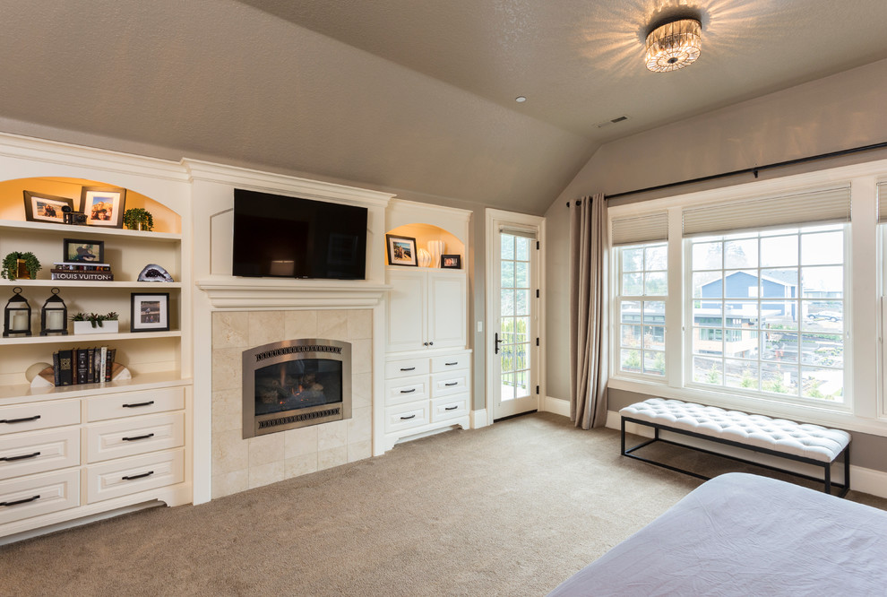Inspiration for a huge transitional master carpeted and beige floor bedroom remodel in Portland with gray walls, a standard fireplace and a wood fireplace surround
