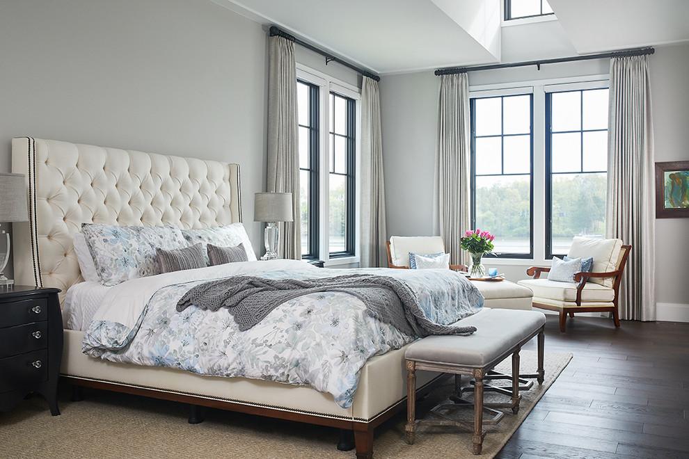 Example of a transitional dark wood floor and brown floor bedroom design in Grand Rapids with gray walls