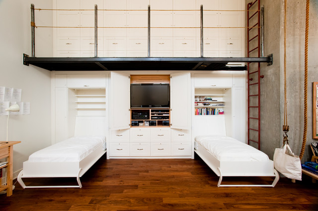 Industrial guest medium tone wood floor bedroom idea in Vancouver with  white walls Custom Wall Unit Houzz