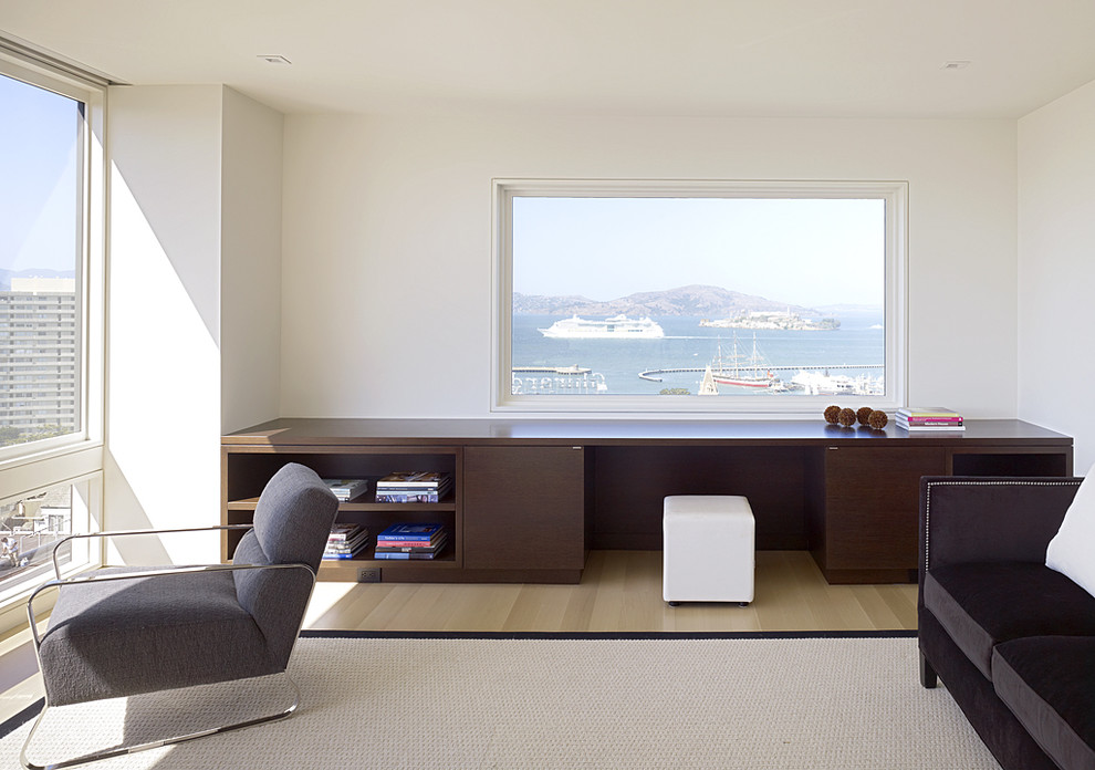 Inspiration for a modern light wood floor bedroom remodel in San Francisco with white walls