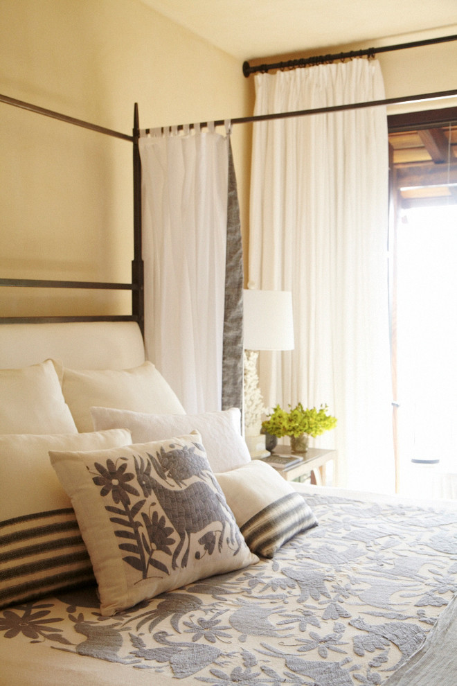 Example of a tuscan bedroom design in Other