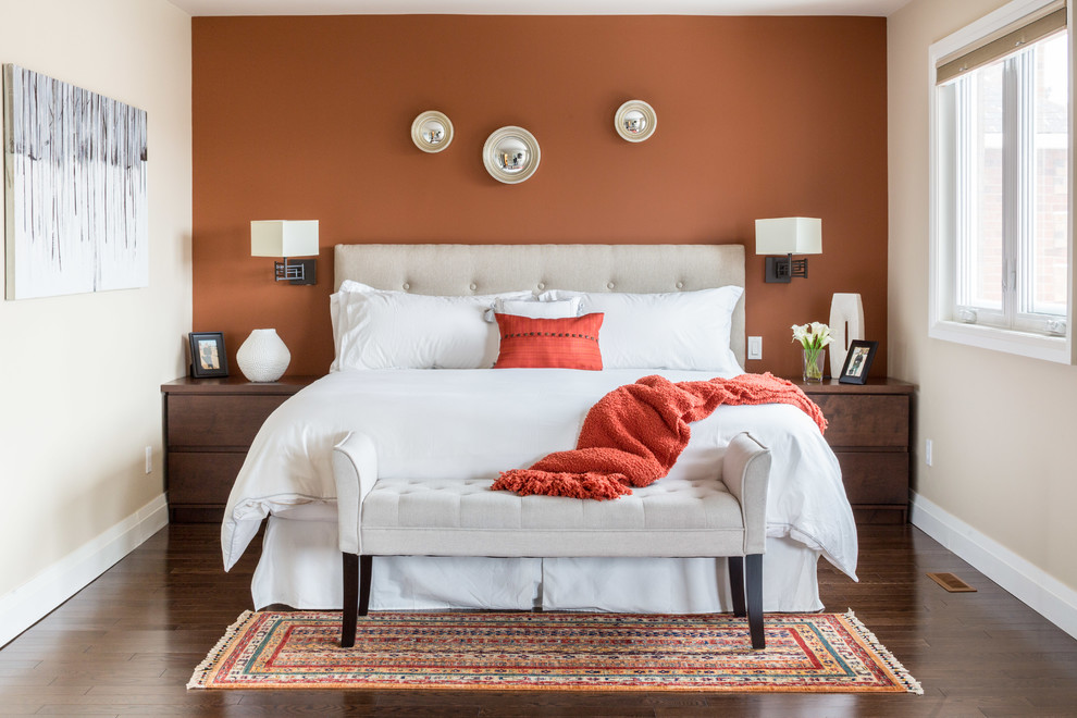 Example of a mid-sized transitional master dark wood floor bedroom design in Toronto with orange walls and no fireplace