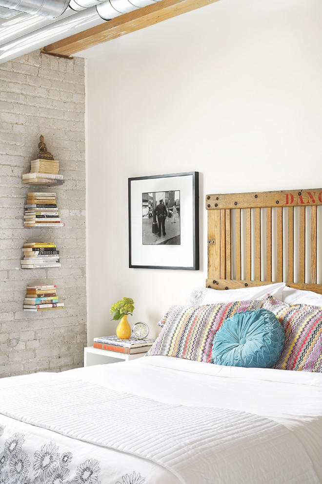 Example of an urban bedroom design in Toronto