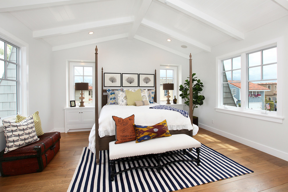 Beach style guest medium tone wood floor bedroom photo in Orange County with white walls and no fireplace