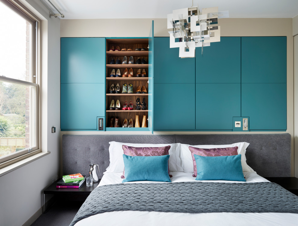 Trendy master carpeted bedroom photo in London