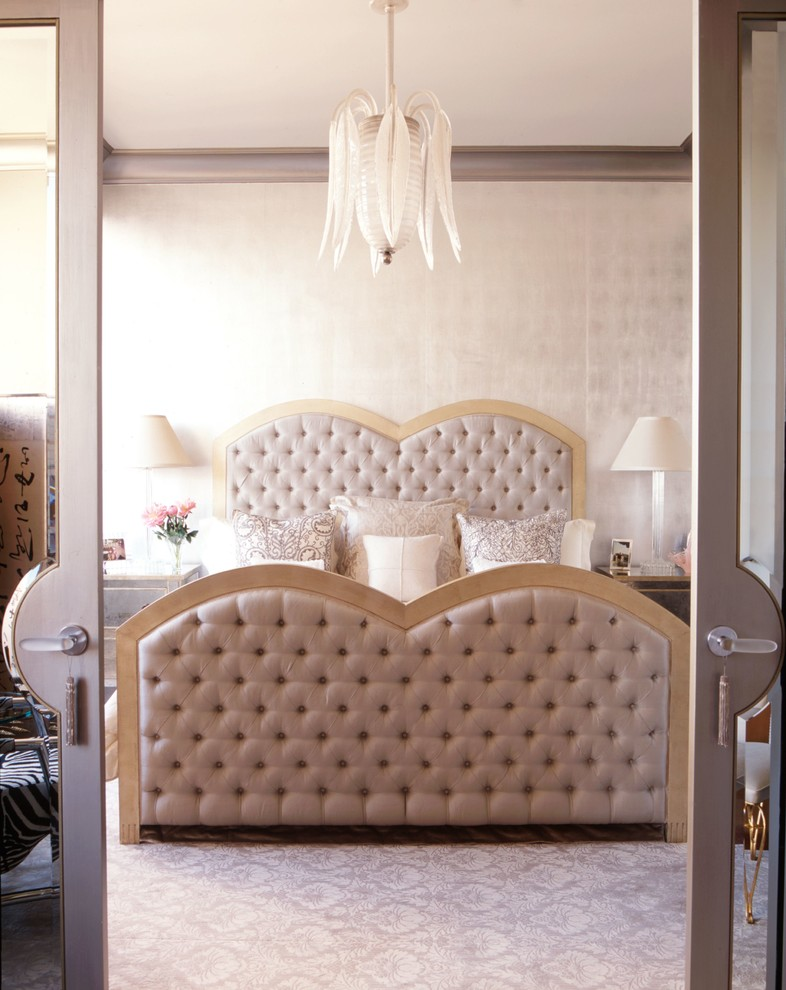 Inspiration for a contemporary bedroom remodel in New York with beige walls