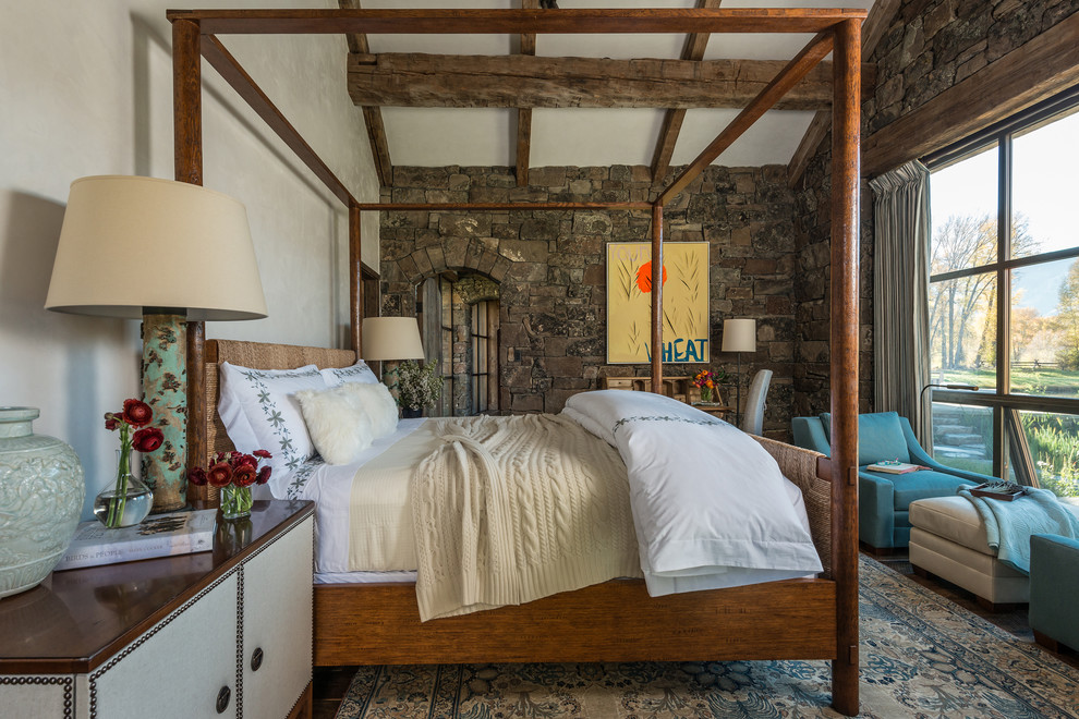 Large mountain style guest dark wood floor bedroom photo in Jackson with brown walls and no fireplace