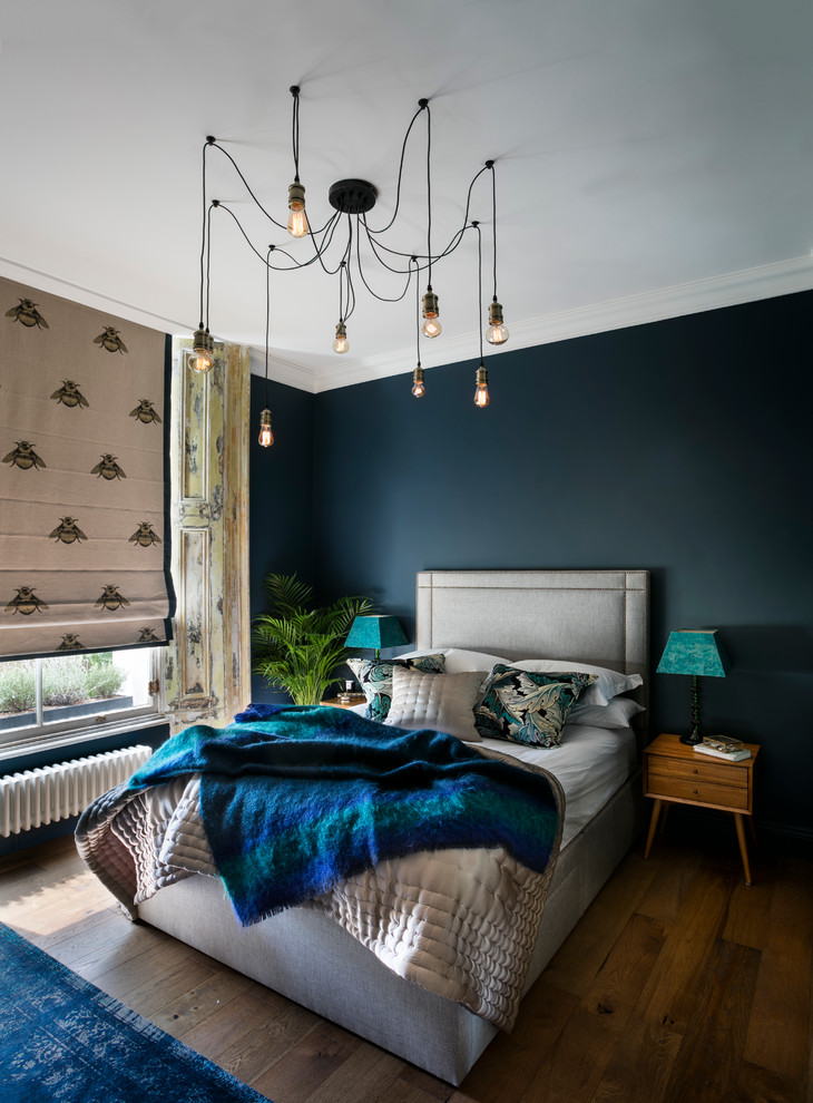 Inspiration for an eclectic master dark wood floor bedroom remodel in London with blue walls