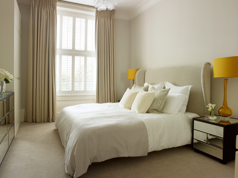 Example of a small trendy master carpeted bedroom design in London with beige walls