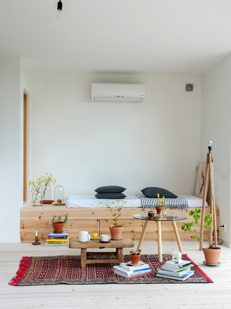 Bedroom - small scandinavian guest light wood floor bedroom idea in Other with white walls and no fireplace