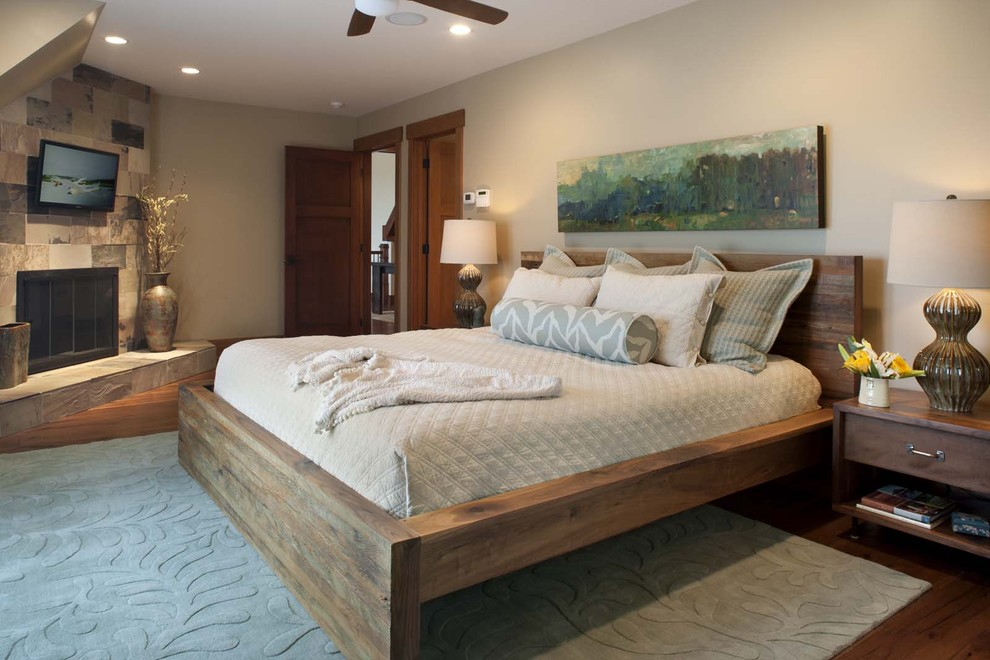 Trendy bedroom photo in Other with a corner fireplace