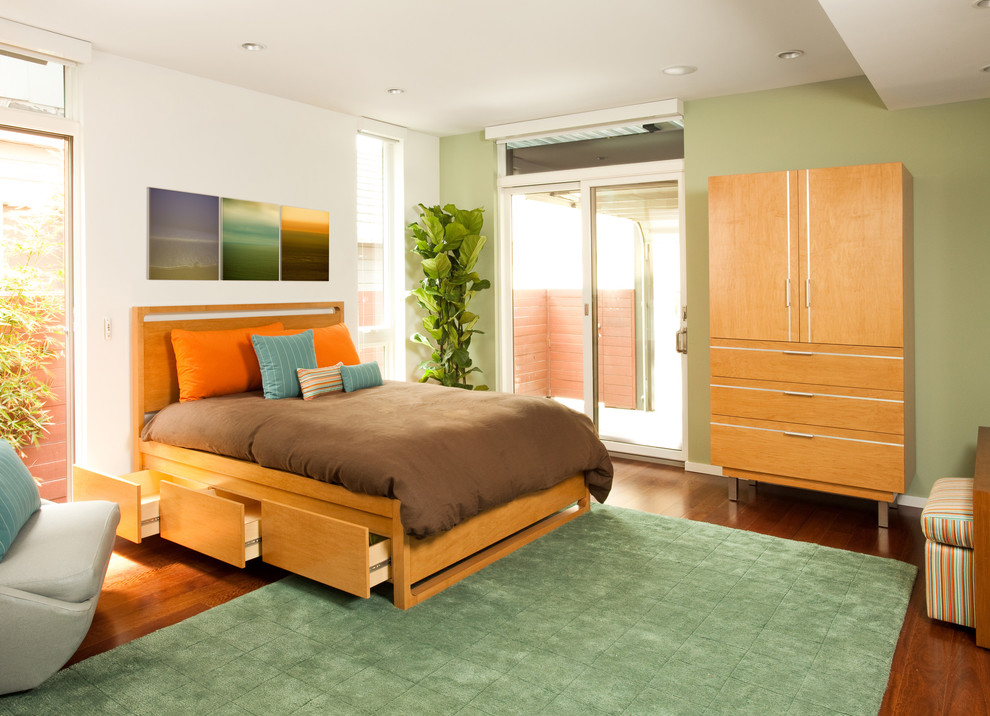 Trendy medium tone wood floor bedroom photo in Los Angeles with green walls and no fireplace