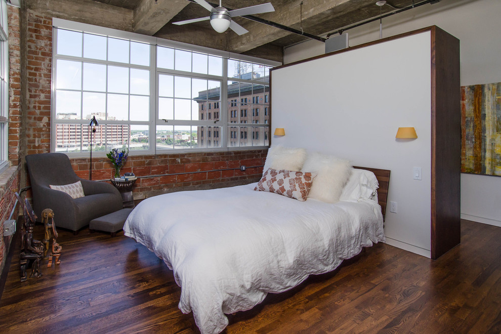 Bedroom - industrial loft-style bedroom idea in Houston