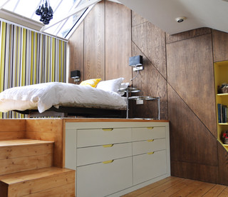 Bed with large storage below.