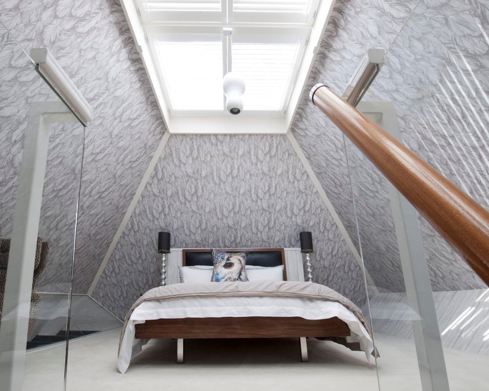 Bedroom - modern loft-style carpeted bedroom idea in Hampshire with gray walls