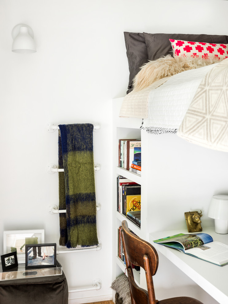Example of a small trendy loft-style light wood floor bedroom design in Chicago with white walls and no fireplace
