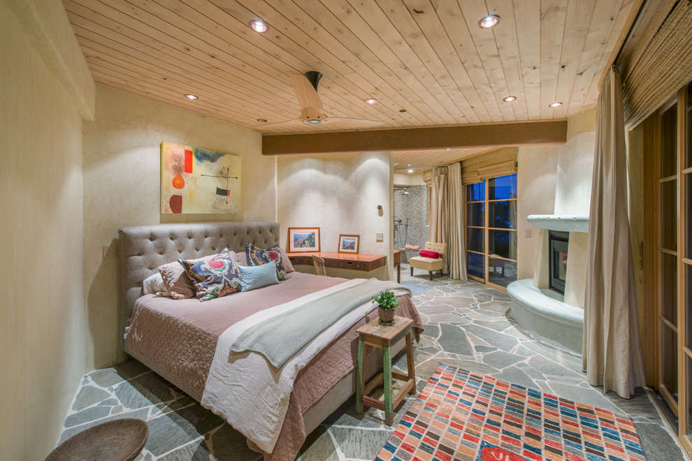 Bedroom - southwestern bedroom idea in San Francisco with beige walls and a corner fireplace