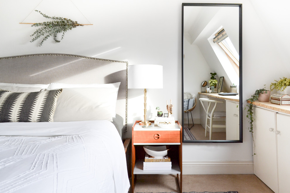Inspiration for a mid-sized scandinavian master carpeted bedroom remodel in London with white walls