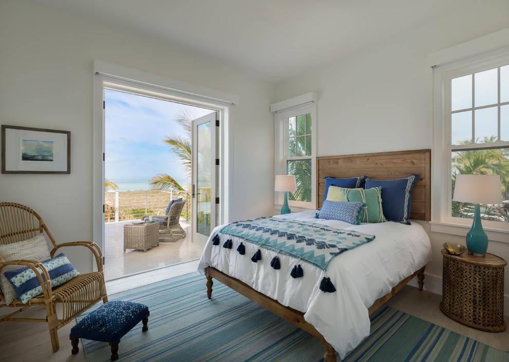 Bedroom - coastal bedroom idea in Tampa with white walls
