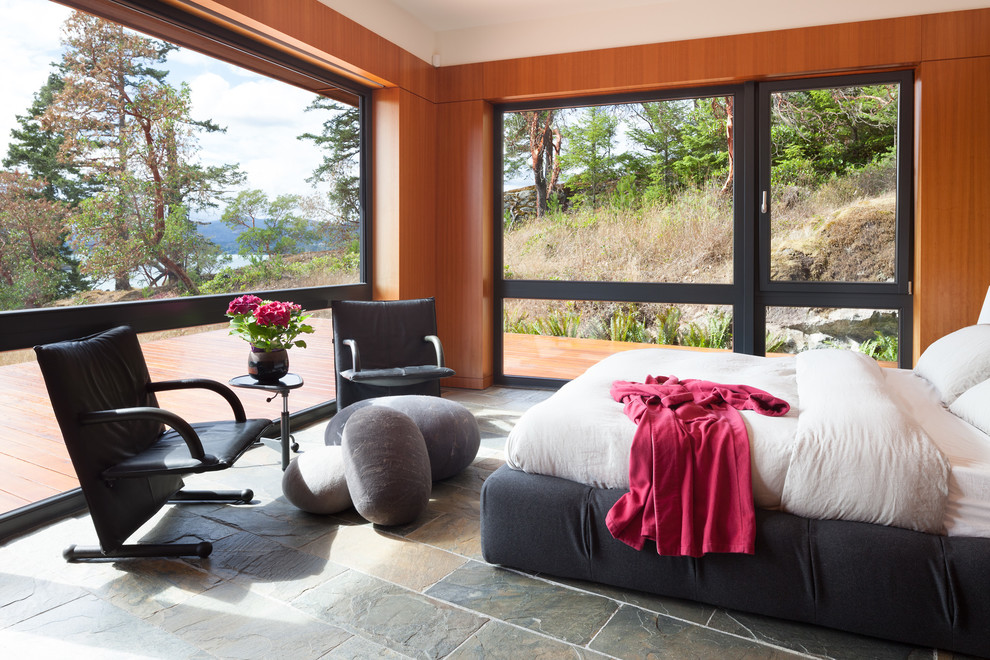 Mid-sized trendy master slate floor and gray floor bedroom photo in Vancouver with brown walls and no fireplace