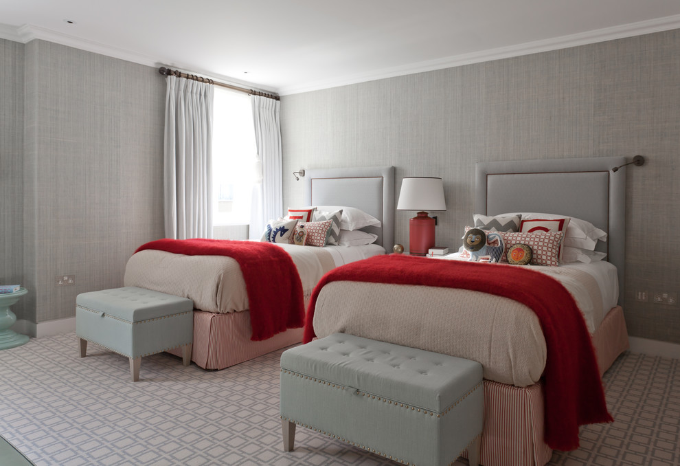 Example of a mid-sized transitional guest carpeted bedroom design in London with gray walls